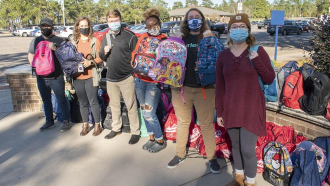 During the University of South Carolina Aiken's annual One Table event, students, faculty and staff brought in nonperishable food items, school supplies and backpacks to be donated to students at Warrenville Elementary School.