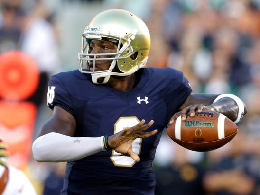 FILE - In this Sept. 5, 2015, file photo, Notre Dame quarterback Malik Zaire looks to a pass during the first half of an NCAA college football game against Texas in South Bend, Ind. Florida coach Him McElwain insists Zaire, who transferred from Notre Dame, journeyman Luke Del Rio and redshirt freshman Feleipe Franks all have a shot at getting the bulk of the snaps. (AP Photo/Nam Y. Huh, File)