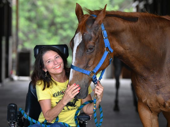 Michelle Slocum with Emily, a 30-year-old horse at