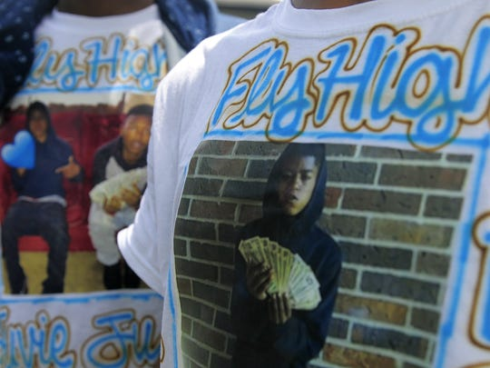Ladarrius Gentry's friends wear T-shirts with his picture