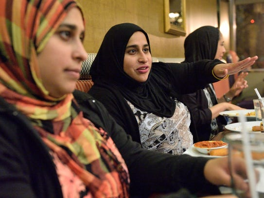 Garha Hussin of Fair Lawn, center, speaks about the
