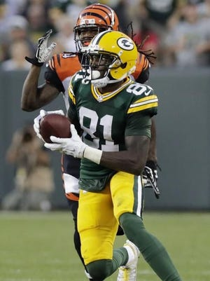 Green Bay Packers wide receiver Geronimo Allison (81) pulls in the ball on a 72-yard catch in overtime against Cincinnati Bengals cornerback Adam Jones (24) on Sunday, September 24, 2017 at Lambeau Field in Green Bay, Wis.