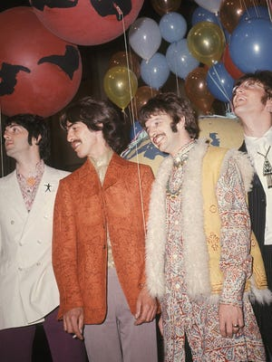 """The Beatles are seen backstage during a June 1967 break in rehearsal for the live broadcast of their new song """"All You Need Is Love"""" on the """"Our World"""" program at EMI studios in London. From left: Paul McCartney, George Harrison, Ringo Starr and John Lennon."""