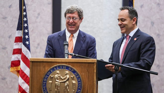 Ben Chandler, CEO of Foundation for a Healthy Kentucky, laughs while Gov. Matt Bevin makes a joke during a partnership announcement of the nonprofit group with the state called Kentucky HEALTH. May 30, 2018.