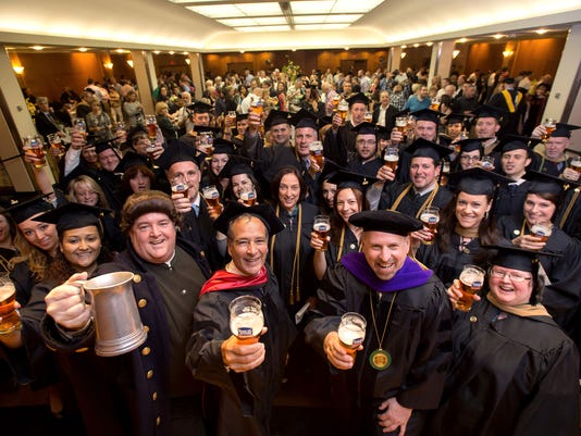 AP_NEW_ENGLAND_COLLEGE_OF_BUSINESS_GRADUATION_64302108