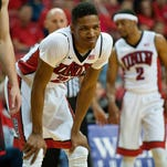 UNLV guard Patrick McCaw (22) smiles at a teammate during the Rebels' win against Southern Utah. UNLV moved up this week's Mountain West basketball rankings.