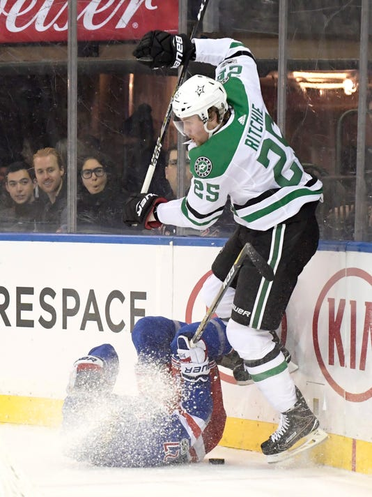 Dallas Stars right wing Brett Ritchie (25) avoids a hit by New York Rangers defenseman Ryan McDonagh (27) during the first period of an NHL hockey game Monday, Dec. 11, 2017, at Madison Square Garden in New York. (AP Photo/Bill Kostroun)