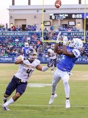 UWF's Rodney Coates (2) beats Mississippi College's