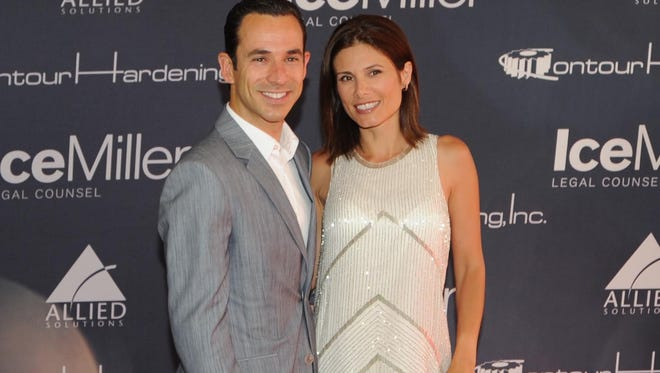Helio Castroneves, shown here with Adriana Henao, won the 40th pole of his IndyCar career Sunday in Houston.