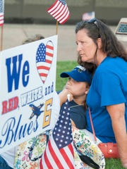 DeAnna Barr, of Deland, FL, and her daughter Grace Barr, 9, during the Candle light vigil for fallen Blue Angels - Marine Capt. Jeff Kuss in Veterans Memorial Park in Pensacola, FL on Thursday, June 9, 2016.  DeAnna Barr was in town to see off her other daughter who is in the Navy.