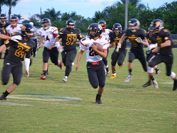 Jaguar quarterback Sevaun Cooper keeps the ball and runs for a first down Friday evening at Merritt Island.