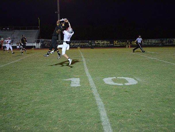 Sean Diggs intercepts the ball Friday evening against Satellite.
