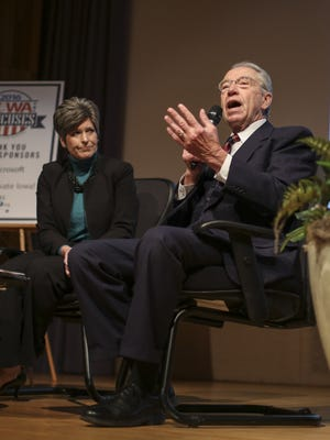 Sen. Joni Ernst, left, and Sen. Chuck Grassley speak at a forum at the State Historical Society on Monday, Nov. 23, 2015, in Des Moines, Iowa.