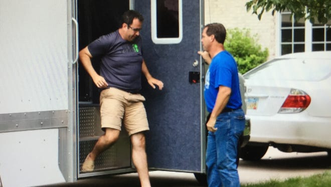Jared Fogle, the Subway pitchman, steps from a police evidence truck parked in the drive of his Zionsville home on Tuesday.