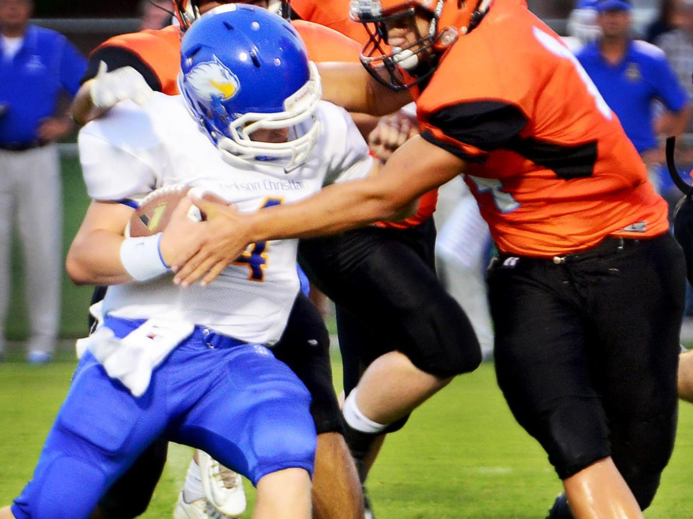 Jackson Christians' Clay Lewis is tackled by an host of South Gibson County defenders during their game Friday.