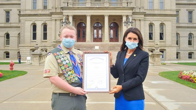 Michigan state Rep. Bronna Kahle, R-Adrian, right, honored Tecumseh Boy Scout Evan Korunka Sept. 30 with a special tribute from the state of Michigan. The tribute recognizes Korunka for becoming an Eagle Scout.