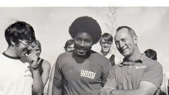 """Thurman """"Wanzo"""" Jordan, center, is joined by former coaches Carlos Viramontes, left, and Rusty Hofacket prior to the start of a Wildcat track and field practice, circa 1974."""
