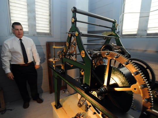 Brad Cosenza talks about the restoration of the mechanics of the clock tower Monday in the courthouse building.