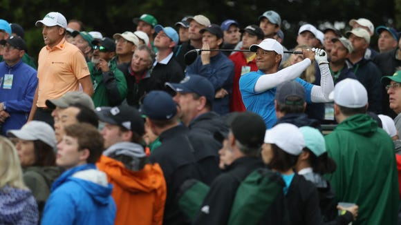 Tiger Woods of the United States plays his shot from the ninth tee during the third round of the 2018 Masters Tournament at Augusta National Golf Club on April 7, 2018 in Augusta, Georgia.
