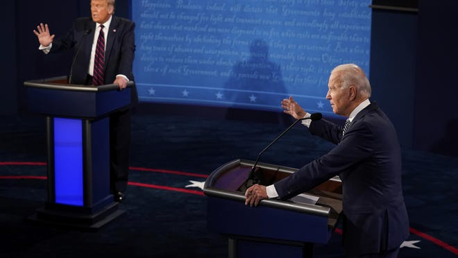 President Donald Trump and Democratic presidential candidate former Vice President Joe Biden exchange points during the first presidential debate Tuesday, Sept. 29, 2020, at Case Western University and Cleveland Clinic, in Cleveland, Ohio.