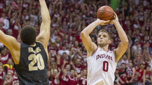 Indiana Hoosiers forward Max Bielfeldt (0) puts up a shot over the defense of Purdue Boilermakers center A.J. Hammons (20) during an NCAA men's college basketball game at Indiana University's Assembly Hall in Bloomington, Ind., Saturday, Feb. 20, 2016. IU won, 77-73.