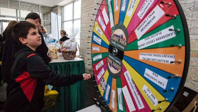 Joe Pellechia of Sussex tries his luck on the prize wheel during Spring Fest 2016. This year's event runs from 9 a.m. to 2 p.m. Saturday, March 10, at Hamilton High School.