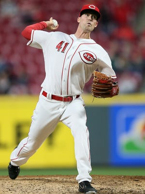 Cincinnati Reds relief pitcher Kevin Shackelford (41) delivers in the eighth inning during the National League baseball game between the Atlanta Braves and the Cincinnati Reds, Wednesday, April 25, 2018, at Great American Ball Park in Cincinnati.