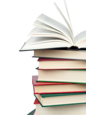 Getty Images/iStockphoto Stack of books. Open book.