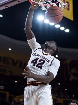 ASU's Jethro Tshisumpa (#42) dunks the ball during the second half on Saturday, Dec. 3, 2016, at Wells Fargo Arena in Tempe, Ariz.