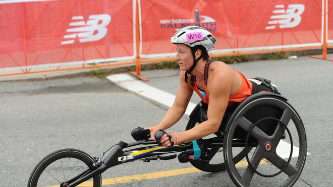 """Tatyana McFadden, here heading to the starting line of the 2019 New Balance Falmouth Road Race, last year recorded her fifth Falmouth victory while setting a course record. She, along with Daniel Romanchuk, who also set a course record in Falmouth last year, headlined Falmouth's at-home wheelchair event on Sunday. McFadden is among several Paralympic athletes profiled in the Netflix documentary """"Rising Phoenix,"""" which she also co-produced."""