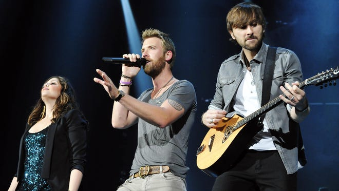 """The former Lady Antebellum starts their first song during their concert at the James Brown Arena in Augusta, Georgia on Tuesday, May 22, 2012. The trio changed the group's name to Lady A to acknowledge the racial sensitivities over the term """"antebellum."""""""