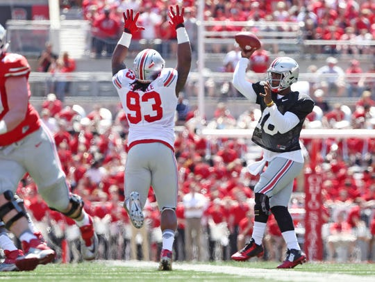 Ohio State quarterback J.T. Barrett throws a pass against