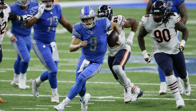 Detroit Lions quarterback Matthew Stafford (9) runs the ball against the Chicago Bears in the first half of an NFL football game in Detroit, Sunday, Sept. 13, 2020.