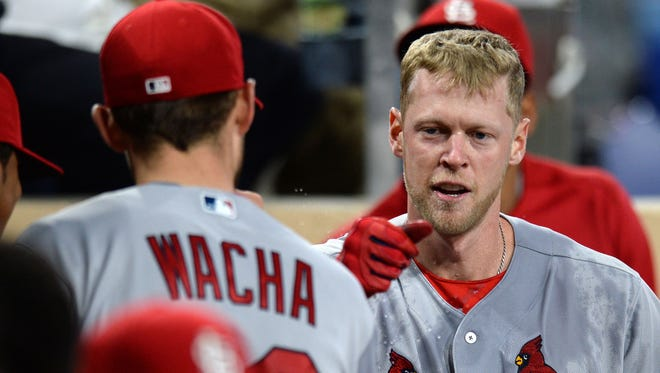 St. Louis Cardinals right fielder Jeremy Hazelbaker is congratulated by starting pitcher Michael Wacha after hitting a three run home run during the seventh inning April 23 against the San Diego Padres at Petco Park.