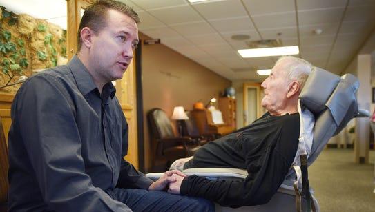James O'Reilly junior sits with his father, James O'Reilly