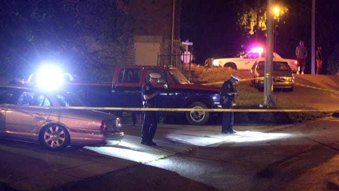 Police investigate a shooting Friday in North Fairmount on Cummins Street. Police say a man was shot in the leg and taken to University of Cincinnati Medical Center.