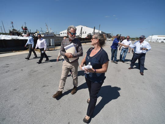 "Christina Bell (right), talks with Richard Spurlock, general manager for Beyel Brothers Crane Service, which has business operations in the port, during a tour of the Port of Fort Pierce property on Tuesday, May 8, 2018, in Fort Pierce. ""It's an exciting progression,"" Bell said. ""The Bell sisters are looking for the highest and best use of the property."" Christina and her sister, Carmela Bell (not pictured), own about 67 acres in the port operations area from their father, the late Lloyd Bell."