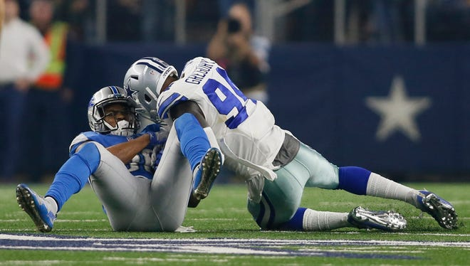 Dallas Cowboys defensive end Randy Gregory (94) tackles Detroit Lions running back Dwayne Washington (36) in the fourth quarter at AT&T Stadium.