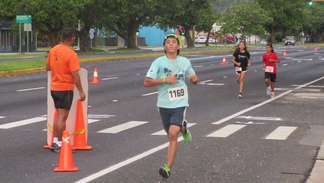 Runners make their way to the finish line last year's ONE Healthy Micronesia Run.