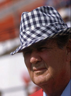 """-  -ADVANCE FOR WEEKEND DEC 7-8--FILE--University of Alabama football coach Paul """"Bear"""" Bryant, is shown Oct. 6, 1979 prior to a game at the University of Alabamba. Retiring Alabama coach Gene Stallings has a wry smile and a presence about him that reminds lots of Alabama fans of Bear Bryant. He also has an .817 winning percentage _ another Bryant-like attribute that's probably the biggest reason he will be compared to Bryant long after he leaves Alabama.(AP Photo/Joe Holloway Jr.)"""
