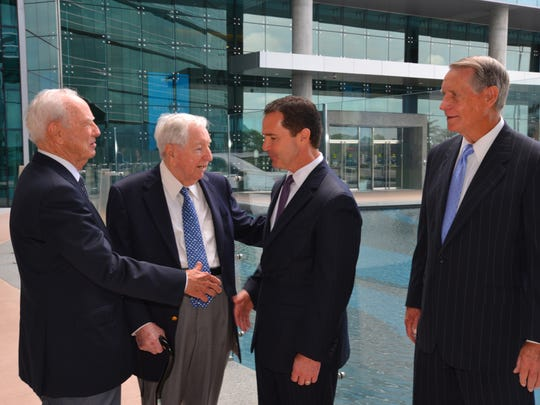 Harris Corp. Chief Executive Officer Bill Brown (third from left) chats with former CEOs (left to right) Jack Hartley, Joseph Boyd and Phil Farmer during the  the February 2015 grand opening of the Harris Technology Center in Palm Bay.