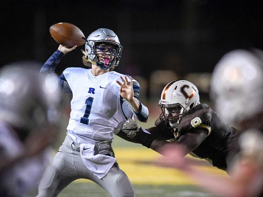 Reitz quarterback Elijah Wiethop (1) looks to pass under intense defensive pressure from Central's Joseph Space (8) in the first half of the Class 4A football sectional opener as Central High plays Reitz at Central Friday, October 20, 2017.