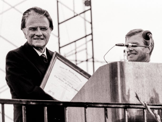 Rev. Billy Graham, left, is given The Order of the