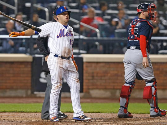 Mets' Asdrubal Cabrera tosses his bat after he struck out swinging to end the seventh inning, as Atlanta Braves catcher Tyler Flowers (25) walks back to the dugout during a baseball game Wednesday, April 26, 2017, in New York.