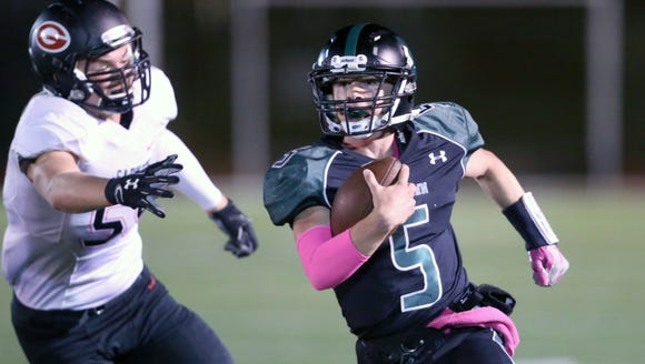 Yorktown's Tommy Weaver (5) breaks a tackle during