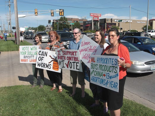 About 30 people gathered on Battlefield Road to protest against Hobby Lobby.