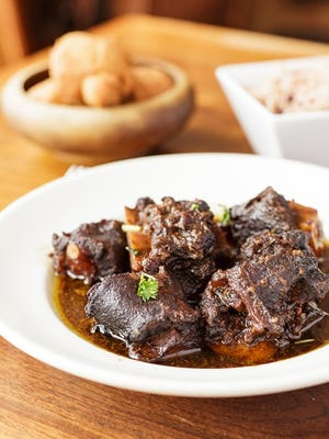 Irie Zulu's South African oxtail stew has carrots, onions, potatoes and special seasonings and is served over rice or polenta.