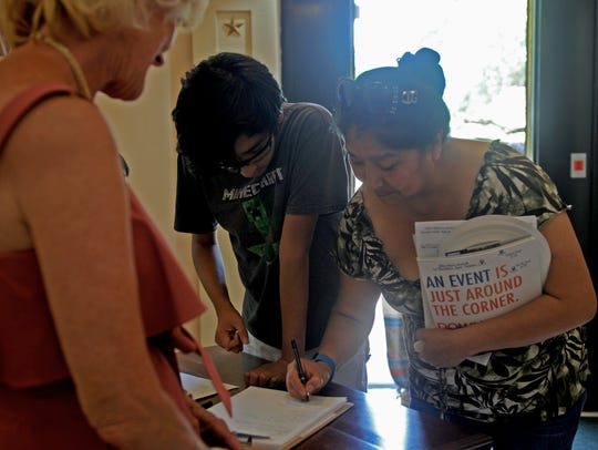 People sign in at the Wichita Falls Public Library 100th birthday party Saturday, June 16, 2018, at the Kemp Center for the Arts. The library sealed up their centennial year with a time capsule that will be opened in 2118.