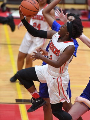 Madisen Smith (22), who led Greenville to the Class AAAA Upper State final as a junior, has committed to play college basketball at West Virginia University.