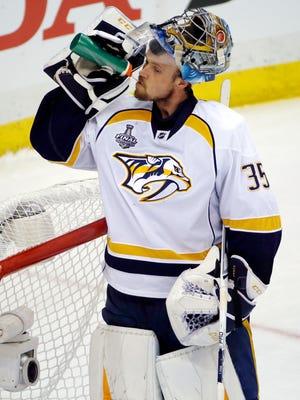 Nashville Predators goalie Pekka Rinne takes a drink during a timeout during the second period in Game 1 of the NHL hockey Stanley Cup Finals against the Pittsburgh Penguins, Monday, May 29, 2017, in Pittsburgh. (AP Photo/Gene J. Puskar)